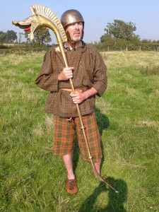 Celtic Warrior standing with a Carnyx